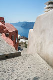 View of the sea and the Caldera with a narrow street of Fira on. The island of Santorini, Greece Stock Photos