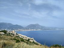 View on sea, castle and mountains in Turkey, Alanya. stock photos