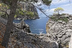 View of the sea and cliffs on a sunny day. With blue sky, postcard idyll, Mallorca Stock Images