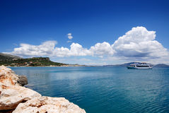 A view of the sea on the coast of Zante Greece. A picture of a cruise liner on the stunning blue sea along the coastline of Zante in Greece Stock Photo