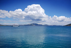A view of the sea on the coast of Zante Greece. A picture of a cruise liner on the stunning blue sea along the coastline of Zante in Greece Royalty Free Stock Photography