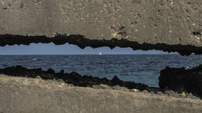 View of the sea through concrete stock photo