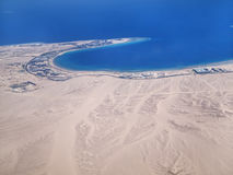View on the sea and the desert from an airplane Stock Photo