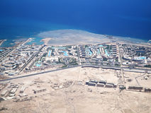 View on the sea and the desert from an airplane Stock Photos