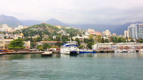View from the sea on the embankment in Yalta stock video