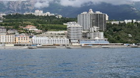 View from the sea on the embankment in Yalta, the Crimea stock video footage