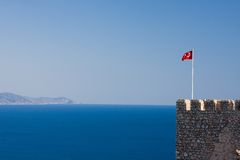 View on sea with flag, Alanya. Turkey Stock Images