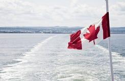 Boat leaving the Canadian coast Stock Photo