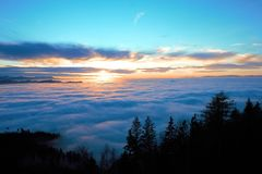 View on sea of fog with some hills sticking out of the mist stock images