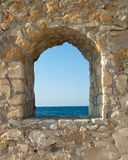 View on the sea from fortress window Stock Photos