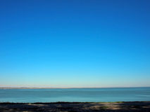 View of the sea and the horizon with the coastline Royalty Free Stock Photos