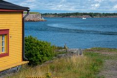View of the sea and a house in Suomenlinna Sveaborg Fortress royalty free stock photo