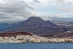 View from sea of Los Cristianos bay, Tenerife, Spain. Los Cristianos is a town on the southwest coast of Tenerife, the largest of Spain's Canary Islands. A Royalty Free Stock Image