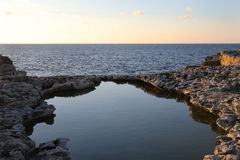 View of the sea from Maltese shore. Rock pool and view of the sea from the shore of Malta Stock Image