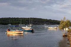 The view of the sea and moored boats Stock Images