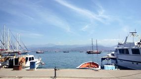 View of the sea, mountains and horizon from the sea bay, port, ships, boats, boats on the pier, blue water and mountains, royalty free stock images