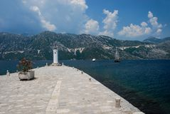 A view of a sea, mountains and a naviagation light from Gospa i royalty free stock images