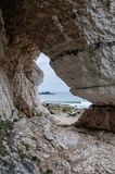 A view of sea through natural rock arch on the North Eastern coast of Northern Ireland stock photo