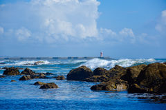 View of sea/ocean with rocks and small waves Stock Image