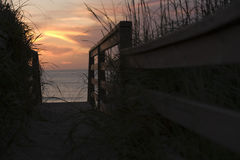 View of sea through pathway leading to beach Stock Photos