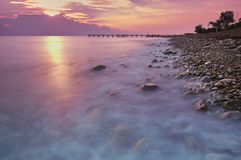 Sunset or sunrise landscape, panorama of beautiful nature, beach with colorful red, orange and purple clouds reflected in the ocea stock images