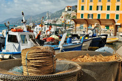 View of the sea port Camogli with boats and fishing tackles Royalty Free Stock Photo