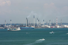 A view of the sea port, Singapore. Singapore, the Republic of Singapore, and often referred to as the Lion City, the Garden City, and the Red Dot, is a global Stock Photography