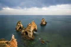 View of the sea in Portimão, Algarve, Portugal. View of the sea and rocks in Portimao, Algarve, Portugal stock photo