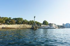 View from the sea on the promenade of the city, Nakhimov Avenue and architectural symbol of the city - the monument to the scuttle. Russia, Crimea, Sevastopol Royalty Free Stock Photo