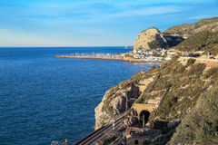 View of the sea and the railway tunnel near the town of El Garraf. Spain. Royalty Free Stock Photo