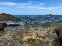 View of sea , rock and boat with blue sky for background royalty free stock images