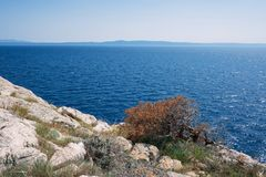 A view of the sea from the rocky mountains of the Croatian shore Royalty Free Stock Photo