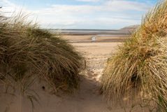 View of Sea through Sand Dunes Royalty Free Stock Image