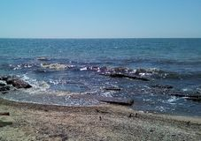 View of the sea from the sandy shore. royalty free stock photo