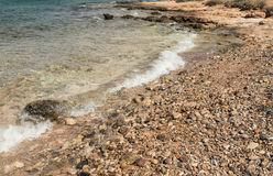 View of the sea shore with small pebbles Royalty Free Stock Image