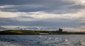 Lighthouse and castle on an island royalty free stock image