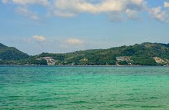 View of the sea, sky and mountains overgrown with jungle Tri Trang Beach in Phuket. Thailand Stock Photo