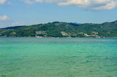 View of the sea, sky and mountains overgrown with jungle Tri Trang Beach in Phuket Stock Photos