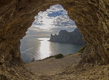 View of the sea from a small rock grotto. Stock Photo