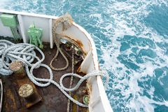 View of sea from stern of boat with many ropes or painters. Stock Photos