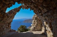 View of sea through stone arch. View of sea through ancient stone arch, Monolithos, Rhodes, Greece Royalty Free Stock Photos