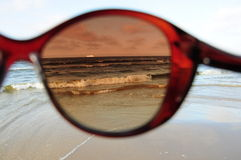 Sea through sunglasses Royalty Free Stock Photography
