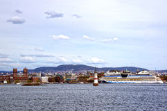 View from the sea to a ferryboat, Oslo and the Oslo Fjord. View from the sea to a ferryboat, ferryboat, Oslo and the Oslo Fjord. Norway, May 08, 2013 Royalty Free Stock Images