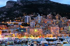 Evening lights of Monaco, view from the sea stock photos