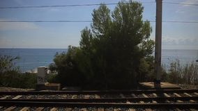 View of the sea and the train rails stock video footage