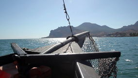View of the sea view from yacht. Travel by wooden boat to land stock video