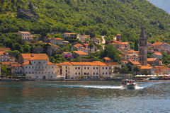 View from sea on the village Perast on coast of Boka Kotor bay. Montenegro. Royalty Free Stock Photography