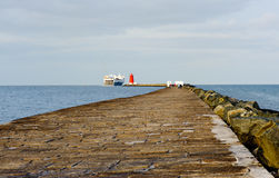 View sea wall protecting harbour Stock Photo