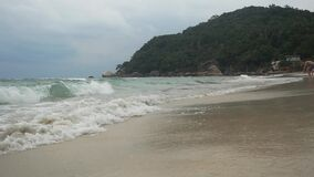 View of sea waves and sandy beach in cloudy weather on tropical island in slow motion. 1920x1080. Hd stock footage