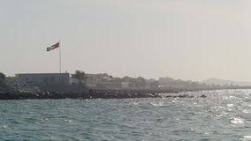 View on a seacoast of UAE in sunny summer day from water stock video footage